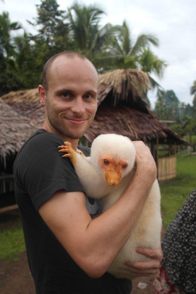 Holding a Cuscus in Papua New Guinea.