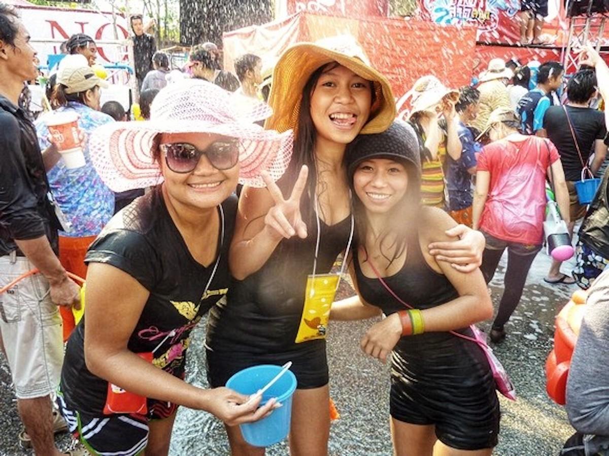 Thai women smile during Thai Water Festival.