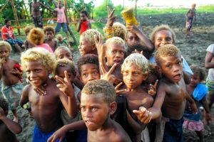 Local kids posing for a travellers hiking in the Solomon Islands