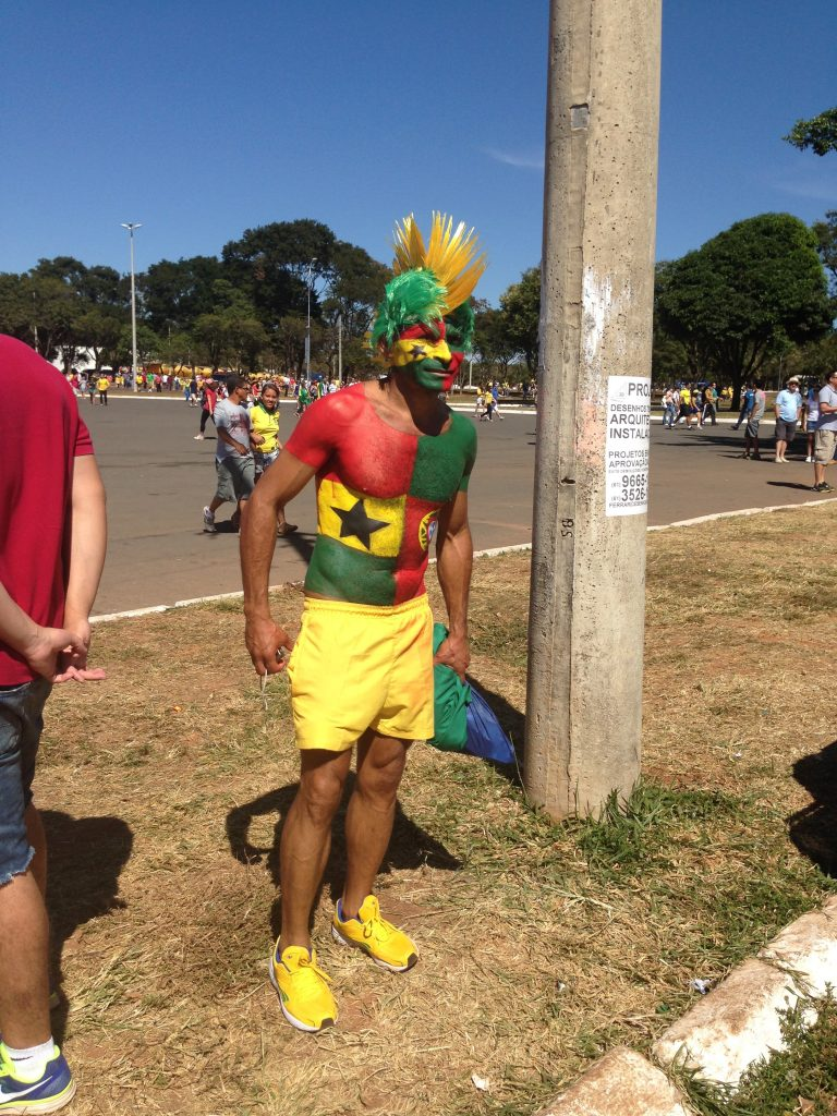 Ghana fan going hard as opposed to going home.