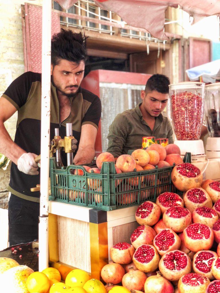 Iraqi men making juice