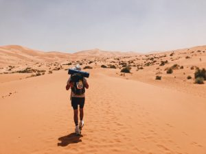 Man walking through Sahara Desert at Marathon des Sables