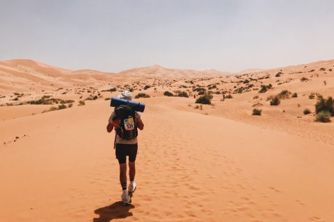 Man walking through Sahara Desert at Marathon des Sables