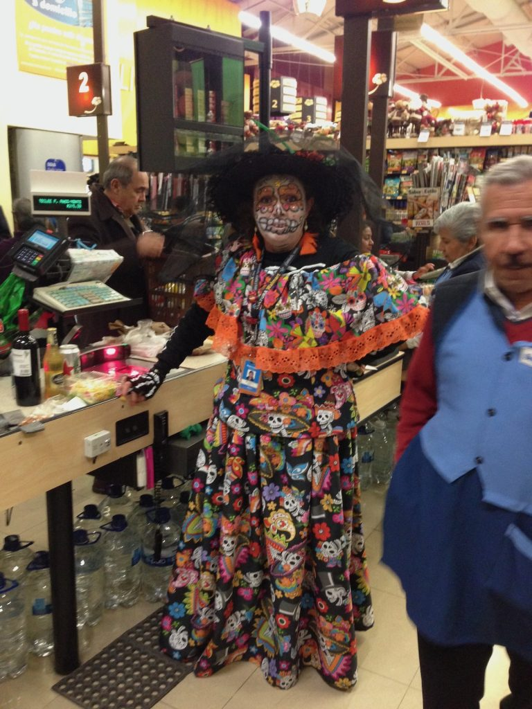 A lady dressed up for the Day Of The Dead Festival