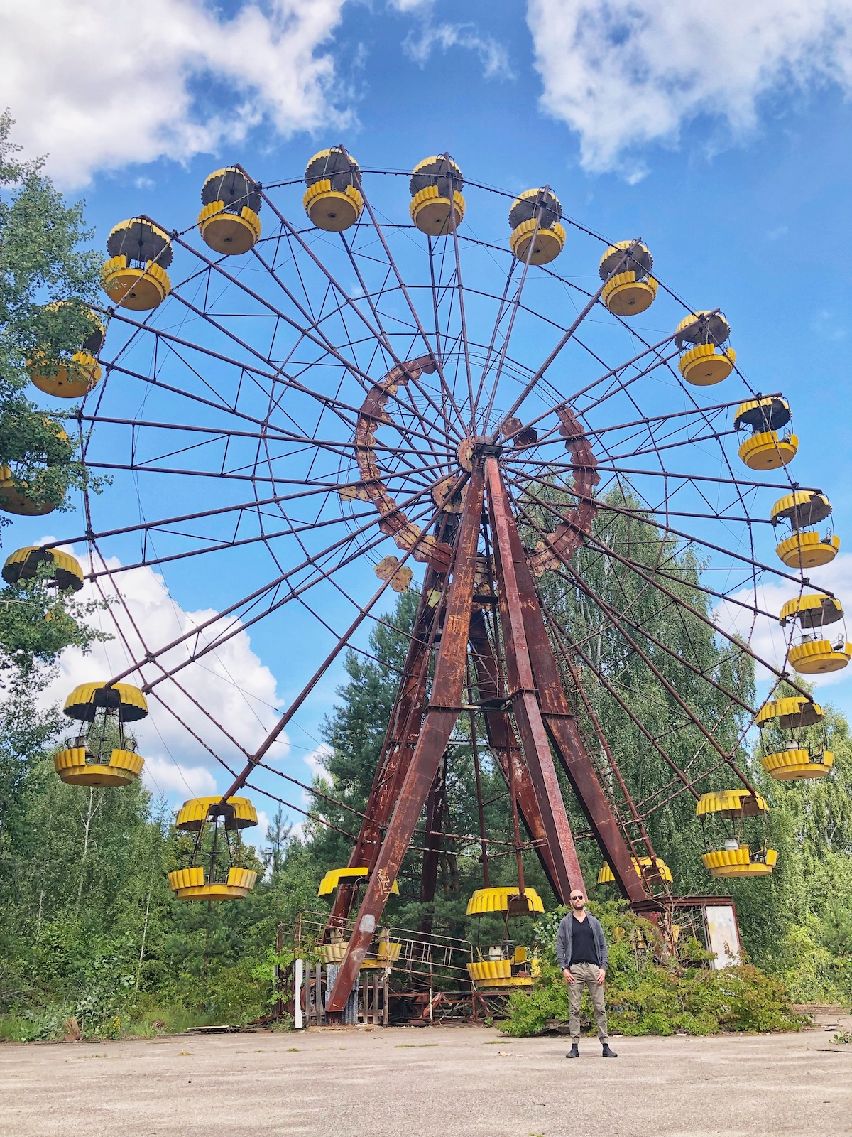 Man stands at abandoned amusement park in Chernobyl.
